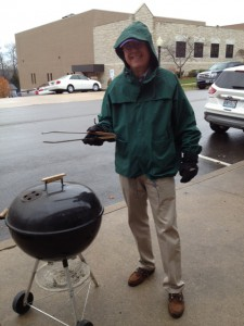 team member with grill outside
